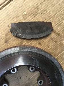 Worn out rotor and pad