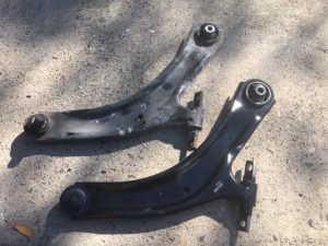 Nissan Xtrail complete front lower arm. Old and New.